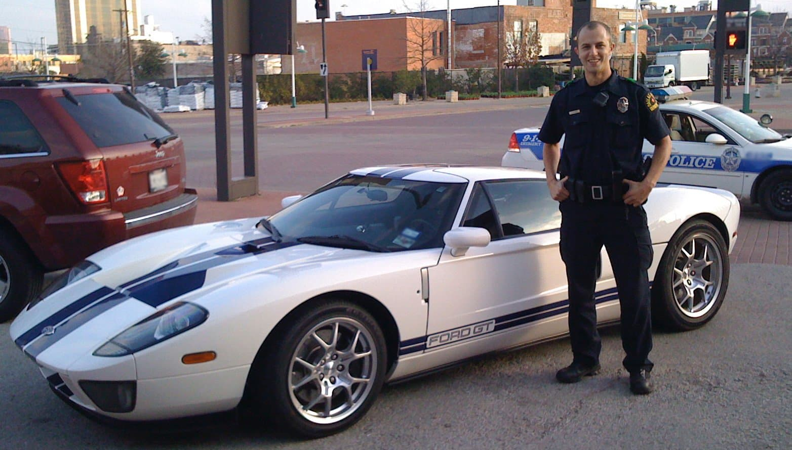 Jared is standing next to a Ford GT that was in his beat at Dallas Police Department.